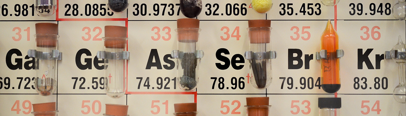 Periodic table with elements in test tubes