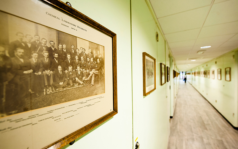A corridor lined with photographs in the Chemistry Building