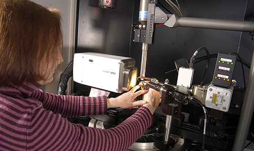 Woman adjusting diffractometer