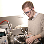 A male researcher using mass spectrometry equipment