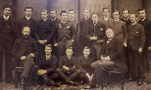 A close-up of an old photograph of people associated with chemistry at the University